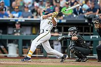 Michigan Wolverines outfielder Jordan Brewer (22) follows through on his swing against the Vanderbilt Commodores during Game 2 of the NCAA College World Series Finals on June 25, 2019 at TD Ameritrade Park in Omaha, Nebraska. Vanderbilt defeated Michigan 4-1. (Andrew Woolley/Four Seam Images)
