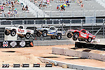 Off road truck racing competitors compete in a Baja Style racing event during the summer X-Games at the Circuit of the Americas race track in Austin, Texas.