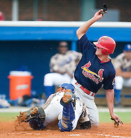 Johnson City's Beau Riportella (7) scores ahead of the tag by Burlington's Tom Hill (44) in the top of the 4th inning at Burlington Athletic Park in Burlington, NC, Sunday, July 15, 2007.