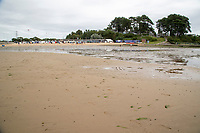 BNPS.co.uk (01202) 558833. <br /> Pic: BNPS<br /> <br /> Pictured: The beach at Rockley Point in Poole Harbour, Dorset. <br /> <br /> There are fresh calls for a holiday park to increase safety measures at a notorious beach where one swimmer has drowned and almost 20 children rescued this summer. <br /> <br /> In the latest incident a dad and his two young sons were plucked to safety in the nick of time after they were swept away by a rip tide at Rockley Park in Poole Harbour, Dorset.<br /> <br /> It happened a month after hero swimmer Callum Baker-Osborne, 18, drowned while helping to rescue 13 children at the same spot.<br /> <br /> And before that two young girls were saved from drowning by a paddleboarder.