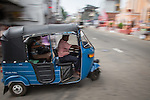 10 March 2015, Kandy, Sri Lanka: An auto rickshaw takes passengers for a ride in downtown Kandy, Central Province, Sri Lanka.  Kandy is the second largest city in the country after Colombo. It was the last capital of the ancient kings' era of Sri Lanka. The city lies in the midst of hills in the Kandy plateau, which crosses an area of tropical plantations, mainly tea. Kandy is both an administrative and religious city and is also the capital of the Central Province. Kandy is the home of The Temple of the Tooth Relic (Sri Dalada Maligawa), one of the most sacred places of worship in the Buddhist world. It was declared a world heritage site by UNESCO in  1988. Picture by Graham Crouch for the New York Times