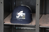 A baseball helmet from the Reno Aces sits in the rack prior to the game against the Salt Lake Bees at Smith's Ballpark on May 4, 2014 in Salt Lake City, Utah.  (Stephen Smith/Four Seam Images)