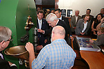 Officials watch as Bruce James mints a medallion in a ceremony marking the beginning of production of the third medallion in the four-part Sesquicentennial series, at the Nevada State Museum in Carson City, Nev., on Friday, May 30, 2014. <br /> Photo by Cathleen Allison