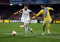 Thursday 27 February 2014<br /> Pictured: Alejandro Pozuelo of Swansea chased by Roberto Colombo of Napoli.<br /> Re: UEFA Europa League, SSC Napoli v Swansea City FC at Stadio San Paolo, Naples, Italy.
