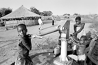 - children near a water pump in Tica refugees camp....- bambini presso una pompa per l'acqua nel campo profughi di Tica