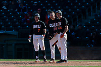 Oregon State Beavers Tyler Malone (7), Adley Rutschman (35), and Alex McGarry (44) stand at home plate and wait for Beau Philip (not pictured) after his home run during a game against the Gonzaga Bulldogs on February 16, 2019 at Surprise Stadium in Surprise, Arizona. Oregon State defeated Gonzaga 9-3. (Zachary Lucy/Four Seam Images via AP)