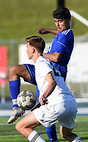 NWA Democrat-Gazette/CHARLIE KAIJO Rogers High School Esteban Chavez (4) dribbles as Bentonville High School Ryan Fox (20) covers during a soccer game, Friday, April 26, 2019 at  Whitey Smith Stadium at Rogers High School in Rogers.