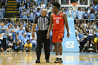CHAPEL HILL, NC - JANUARY 11: Official Bill Covington talks with John Newman III #15 of Clemson University during a game between Clemson and North Carolina at Dean E. Smith Center on January 11, 2020 in Chapel Hill, North Carolina.