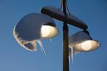 The snow almost slid off the lamp on the previous day, just enough to cause the ice cycles to hang at an unnatural angle.