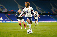 LE HAVRE, FRANCE - APRIL 13: Crystal Dunn #19 of the United States moves towards the box during a game between France and USWNT at Stade Oceane on April 13, 2021 in Le Havre, France.