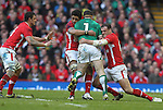 Toby Faletau and Jamie Roberts combine to stop Ireland prop Cian Healy..RBS 6 Nations.Wales v Ireland.Millennium Stadium.02.02.13.©Steve Pope-SPORTINGWALES