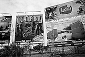 """Culiacan, Sinaloa<br /> Mexico<br /> June 14, 2007<br /> <br /> Billboards advertise the life of the rich narco-trafficker in a town surrounded mostly agricultural farms.  <br /> <br /> Says one local journalist about Culiacan, """"here even if you are not a narco, you want to look like one."""""""