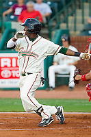 Rand Smith #21 of the Greensboro Grasshoppers follows through on his swing against the Lakewood BlueClaws at NewBridge Bank Park July 6, 2010, in Greensboro, North Carolina.  Photo by Brian Westerholt / Four Seam Images