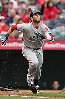 Dustin Pedroia #15 of the Boston Red Sox bats against the Los Angeles Angels at Angel Stadium in Anaheim, California on April 24, 2011. Photo by Larry Goren/Four Seam Images