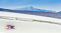 5 December 2014: Tucker West, sliding for the USA, banks through Curve 14 on his first run, ending the day with a 1st place, Gold Medal finish and a combined 2-run time of 1:42.117 in the Men's Competition at the Viessmann Luge World Cup, at the Olympic Sports Track in Lake Placid, New York, USA. Mandatory Credit: Ed Wolfstein Photo *** RAW (NEF) Image File Available ***