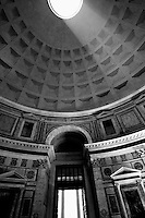 A ray of light streams through the opening of the Pantheon in Rome, Italy.