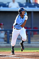 Charlotte Stone Crabs shortstop Leonardo Reginatto (16) runs to first after an at bat during a game against the Palm Beach Cardinals on April 12, 2014 at Charlotte Sports Park in Port Charlotte, Florida.  Palm Beach defeated Charlotte 6-2.  (Mike Janes/Four Seam Images)