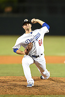 Glendale Desert Dogs pitcher Daniel Coulombe (64) during an Arizona Fall League game against the Peoria Javelinas on October 13, 2014 at Camelback Ranch in Phoenix, Arizona.  The game ended in a tie, 2-2.  (Mike Janes/Four Seam Images)