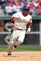 Philadelphia Phillies outfielder Shane Victorino #8 runs the bases during their home opener against the Miami Marlins at Citizens Bank Park on April 9, 2012 in Philadelphia, Pennsylvania.  Miami defeated Philadelphia 6-2.  (Mike Janes/Four Seam Images)