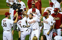 Jun. 8, 2012; Phoenix, AZ, USA; Arizona Diamondbacks third baseman Ryan Roberts (center) celebrates with teammates after hitting a three run walk off home run in the ninth inning against the Oakland Athletics at Chase Field.  Mandatory Credit: Mark J. Rebilas-