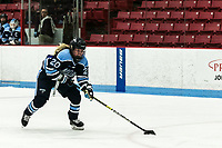 BOSTON, MA - JANUARY 04: Celine Tedenby #20 of University of Maine break away during a game between University of Maine and Boston University at Walter Brown Arena on January 04, 2020 in Boston, Massachusetts.