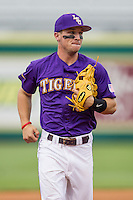 LSU Tigers shortstop Alex Bregman (8) warms up before the Southeastern Conference baseball game against the Texas A&M Aggies on April 24, 2015 at Alex Box Stadium in Baton Rouge, Louisiana. LSU defeated Texas A&M 9-6. (Andrew Woolley/Four Seam Images)