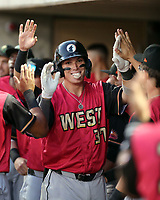 Tyler Stephenson is congratulated by teammates after hitting a home run in the annual Arizona Fall League Fall Stars Game at Salt River Fields on October, 12, 2019 in Scottsdale, Arizona (Bill Mitchell)