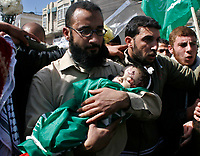 "Palestinian father of Mohammad Al-bourai  6-month-old  thro whis funeral in Gaza February 28, 2008. Al-Borai was killed after Israeli military aircraft bombed the Hamas-run Interior Ministry in Gaza city on Wednesday, hospital officials said.""photo by Fady Adwan"""