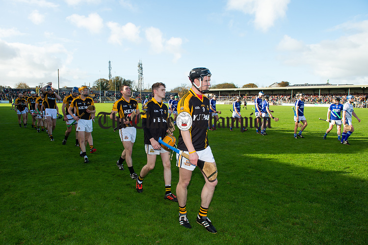Ballyea captain Tony kelly leads his team behind the band before the county senior hurling final against Cratloe at Cusack Park. Photograph by John Kelly.