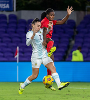 ORLANDO, FL - FEBRUARY 21: Agustina Barroso #2 of Argentina fights for the ball with Nichelle Prince #15 of Canada during a game between Canada and Argentina at Exploria Stadium on February 21, 2021 in Orlando, Florida.