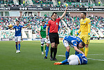 Hibs v St Johnstone….24.08.19      Easter Road     SPFL <br />Ref Don Robertson books Ofir Marciano after he took out Michael O'Halloran<br />Picture by Graeme Hart. <br />Copyright Perthshire Picture Agency<br />Tel: 01738 623350  Mobile: 07990 594431