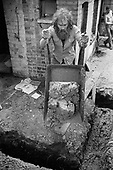 Drainage repairs at 17 Carol Street, one of a row of squatted houses in Camden Town, London, which was later granted short-life status and subsequently became a council-supported housing co-operative.