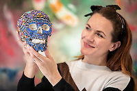 BNPS.co.uk (01202) 558833. <br /> Pic: CorinMesser/BNPS<br /> <br /> Pictured: Butterfly Skull, by Kristjana S Williams, is just one of the works customers will see when the door open on Monday morning. <br /> <br /> Ally Webb puts the finishing touches to displays as she prepares to reopen the Westover Gallery in Bournemouth, Dorset on Monday.