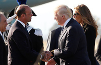 U.S. President Donald Trump, center, and his wife Melania, right, are welcomed by Italian Foreign Minister Angelino Alfano, left, after disembarking from Air Force One at Rome's Fiumicino international airport, May 23, 2017. Trump will meet Pope Francis, at the Vatican, and Italian President Sergio Mattarella, on May 24.<br /> UPDATE IMAGES PRESS/Riccardo De Luca
