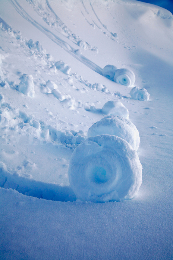 "Snow ""rolls"" created when wet snow broke off a small cornice, Lost Lake region, Chugach National Forest, near Seward, Alaska"
