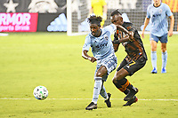 KANSAS CITY, UNITED STATES - AUGUST 25: Gerso Fernandes #12 of Sporting Kansas City runs with the ball  a game between Houston Dynamo and Sporting Kansas City at Children's Mercy Park on August 25, 2020 in Kansas City, Kansas.