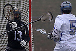 Luke Maul (left) goalie for Southern Regional High School awaits the shot from Justin Cohen (right) of Holmdel High School as Holmdel takes on Southern Regional in a boys varsity lacrosse game held at Roggy Field at Holmdel High School in Holmdel on Thursday March 29, 2018.<br />  Mark R. Sullivan | For NJ Advance Media