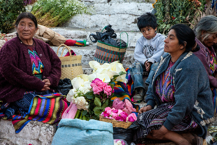 Chichicastenango, Guatemala.  Quiche (Kiche, K'iche') Women Selling Flowers on Steps of Santo Thomas Church on Sunday Morning.