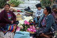 Chichicastenango, Guatemala.  Quiche (Kiche, K'iche') Women Selling Flowers on Steps of Santo Thomas Church on Sunday Morning.