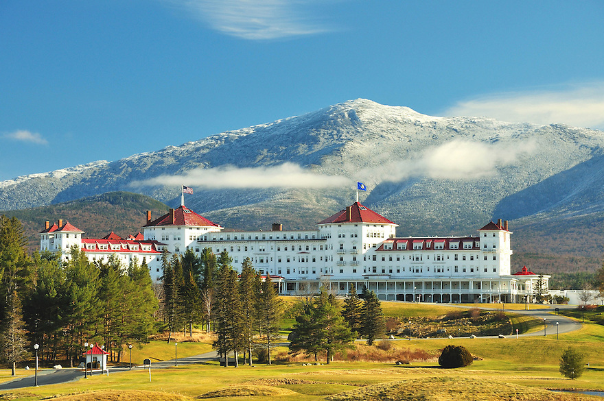 The Mount Washington Hotel on an early fall morning with Mt Jefferson, cloaked in a fresh coating of heavy frost, looming in the distance.