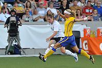 Heather O'Reilly.Sara Thunebro...USWNT tied Sweden 1-1 at Morrison Stadium, Omaha Nebraska.