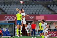 TOKYO, JAPAN - JULY 21: Carli Lloyd #10 of the United States and Amanda Ilestedt #13 of Sweden in aerial challenge for the ball during a game between Sweden and USWNT at Tokyo Stadium on July 21, 2021 in Tokyo, Japan.