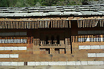 Part of the exterior wall  and roof of the Vashisht temple.Vashisht  was one of the Saptarishis (seven great sages) and spiritual master (guru) of Lord Rama..Vashisht, Kullu Valley  Himachal Pradesh, India.