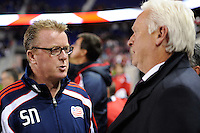 New England Revolution head coach Steve Nicol talks with New York Red Bulls head coach Hans Backe before the match. The New York Red Bulls defeated the New England Revolution 2-0 during a Major League Soccer (MLS) match at Red Bull Arena in Harrison, NJ, on October 21, 2010.