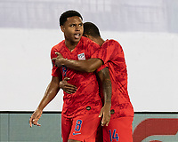 NASHVILLE, TN - JULY 3: Weston Mckennie #8 is congratulated for his goal by Reggie Cannon #14 during a game between Jamaica and USMNT at Nissan Stadium on July 3, 2019 in Nashville, Tennessee.