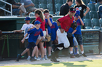 A young baseball player takes the field with Kannapolis Intimidators second baseman Mitch Roman (10) prior to the game against the Hagerstown Suns at Kannapolis Intimidators Stadium on June 15, 2017 in Kannapolis, North Carolina.  The Intimidators defeated the Suns 9-1 in game two of a double-header.  (Brian Westerholt/Four Seam Images)