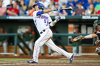 Florida Gators second baseman Dalton Guthrie (5) follows through on his swing against the Miami Hurricanes in the NCAA College World Series on June 13, 2015 at TD Ameritrade Park in Omaha, Nebraska. Florida defeated Miami 15-3. (Andrew Woolley/Four Seam Images)