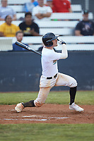 Nick Solomita (7) (UNC Greensboro) of the Mooresville Spinners follows through on his swing against the Statesville Owls at Moor Park on June 14, 2020 in Mooresville, NC.  The Owls defeated the Spinners 8-7 in 10 innings. (Brian Westerholt/Four Seam Images)