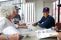 Northwest Arkansas Naturals outfielder Blake Perkins (44) signs autographs for fans on May 4, 2019, at Arvest Ballpark in Springdale, Arkansas. (Jason Ivester/Four Seam Images)