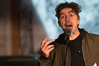 """Michele Riondino (Actor, globally famous to be Salvo Montalbano in the TV Series """"The Young Montalbano"""") performing a monologue about and with Don Andrea Gallo (http://bit.do/fLEV7).<br /> <br /> Rome, 03/12/2020. Today, the Nuovo Cinema Palazzo Community held a second public assembly (1.) in Rome's San Lorenzo district to protest against the eviction of the """"Nuovo Cinema Palazzo"""" completed by the Italian police forces in the early morning of the 25th of November and to demonstrate against the violent reaction of the Police forces when, in the evening of the same day, a large demo asked to have the chance to hold a public assembly in the square (Piazza dei Sanniti) of the cinema (2.). The public assembly of today saw the participation and the support & solidarity of the representatives of movements, actors, musicians, students, artists, politicians, and citizens of San Lorenzo who told their stories and memories related to the famous Rome's Art and culture occupation (For example, actor Marcello Fonte, Best Actor Award of the 2018 Cannes Film Festival for the film Dogman, was among the first group of occupiers of the Nuovo Cinema Palazzo). The assembly of the 1st December was interrupted due to the bad weather (3).<br /> The Nuovo Cinema Palazzo was occupied the 15th of April 2011, when citizens, movements, workers of the entertainment industry reopened the former """"Palazzo Cinema"""" to prevent the opening of a casino/gambling space. The illegal occupation was intended as a public hub of art, culture, sport and politics, an open place for exchange, discussion, studies, caring and sharing.<br /> <br /> Footnotes & Links:<br /> 1. http://bit.do/fLCpE<br /> 2. Demo And Clashes Against Nuovo Cinema Palazzo Eviction in Rome's San Lorenzo: http://bit.do/fLxgz<br /> 3. http://bit.do/fLCr3<br /> Previous Stories about Nuovo Cinema Palazzo: 14.04.2018 - Nuovo Cinema Palazzo's Concert: """"7 Anni di CasiNò 